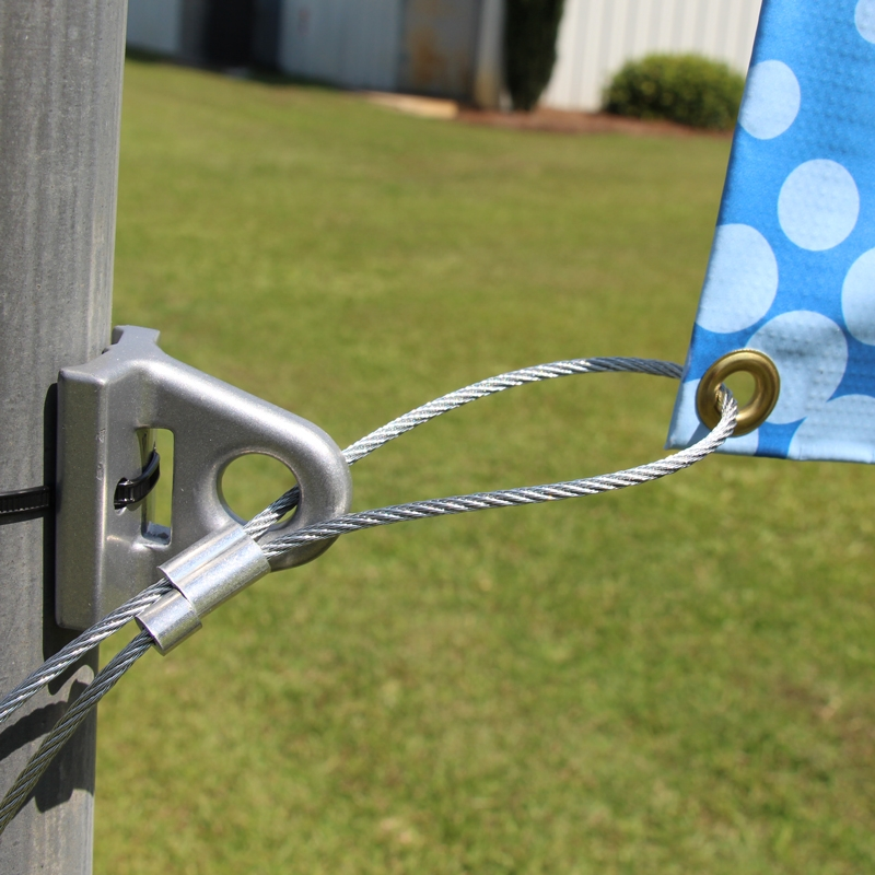 Banner with Galvanized cable and ferrule stop on tie-down bracket and zip ties